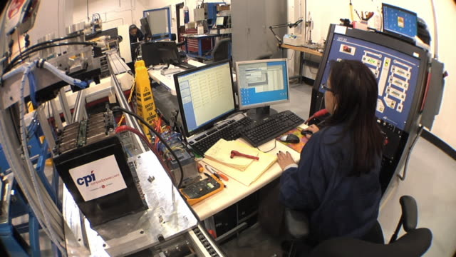 ms technician using multiple computer screens while testing prototype lithium ion battery used to power electric automobile / troy, michigan, usa - lithium ion battery stock videos & royalty-free footage