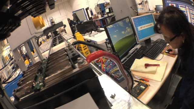 cu pan technician using multiple computer screens while testing prototype lithium ion battery used to power electric automobile / troy, michigan, usa - lithium ion battery stock videos & royalty-free footage
