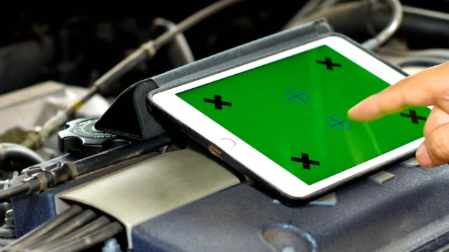 technician using tablet with green screen for diagnostic car, car maintenance concept - aggiustare video stock e b–roll