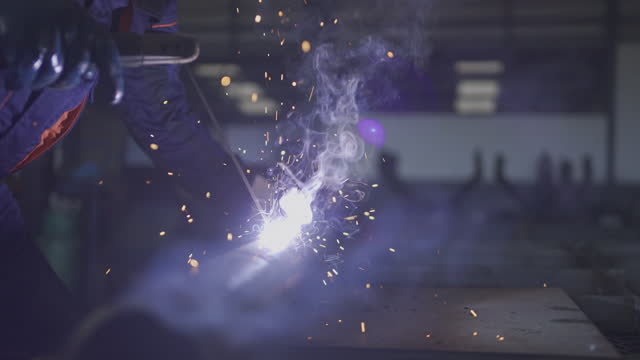 technician welding steel pipe in the workshop. - sparks stock videos & royalty-free footage