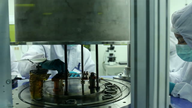 technician with microchip in the lab clean room - nanotecnologia video stock e b–roll