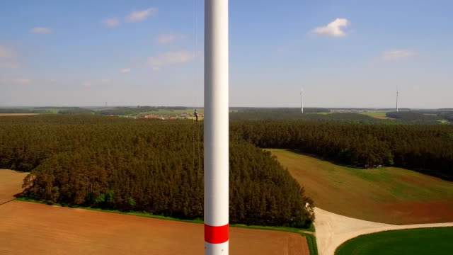 technician worker roping down on windmill - abseiling stock videos & royalty-free footage
