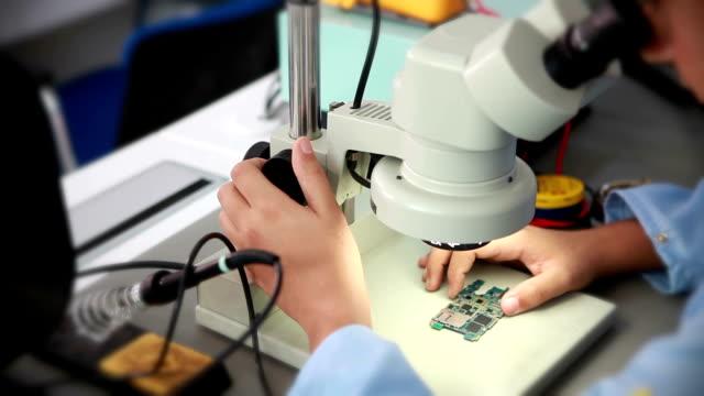 technician working on microscope