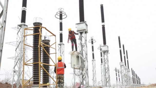 A technician works on a circuit breaker at the Sterlite Power Transmission Ltd Gas Insulated Substation which is under construction in Amargarh Jammu...