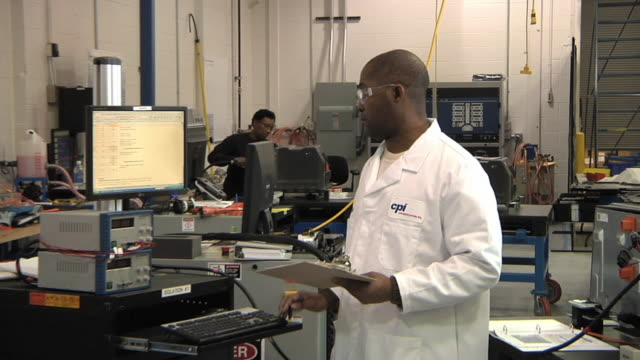 ms zo technician writing notes while testing prototype lithium ion battery used to power electric automobile / troy, michigan, usa - lithium ion battery stock videos & royalty-free footage