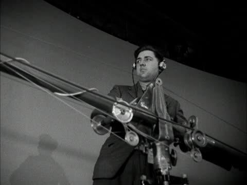 vídeos y material grabado en eventos de stock de technicians assemble and check a mike boom in the new bbc children's hour studio at lime grove 1950 - bbc