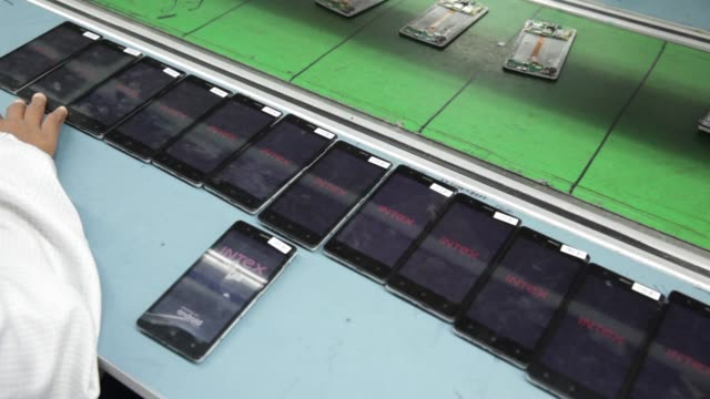 technicians assemble smartphones on the production line inside the intex technologies india ltd. plant in noida, uttar pradesh, india, on friday,... - electronics industry stock videos & royalty-free footage