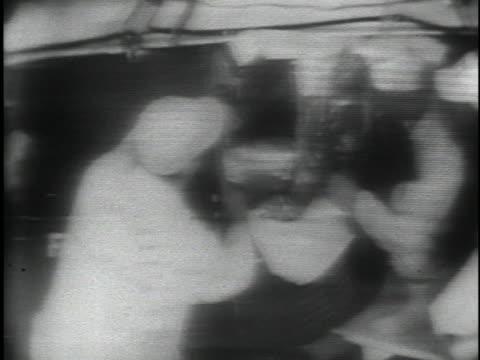 technicians assist astronaut alan shepard into a space capsule. - alan b. shepard jr stock videos & royalty-free footage