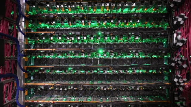 stockvideo's en b-roll-footage met technicians at work in bitfarms technology lab repairing computer miners and the actual bitcoin mining facility in montreal, canada on thursday, july... - mining