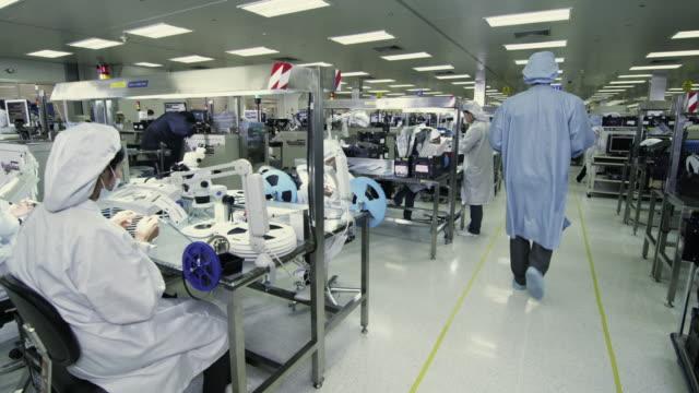 WS PAN Technicians at work manufacturing semiconductors / Bang Pa-In, Ayutthaya, Thailand