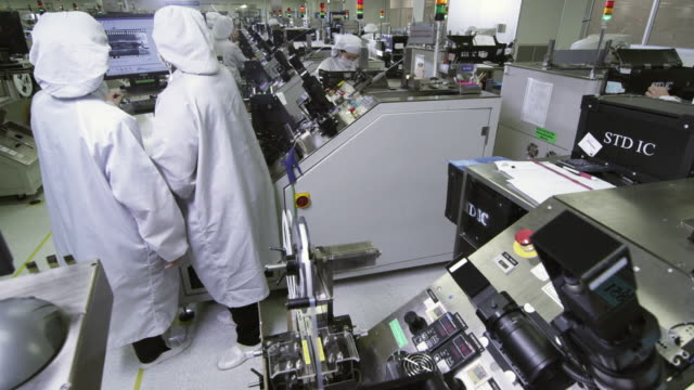 MS Technicians at work manufacturing semiconductors / Bang Pa-In, Ayutthaya, Thailand