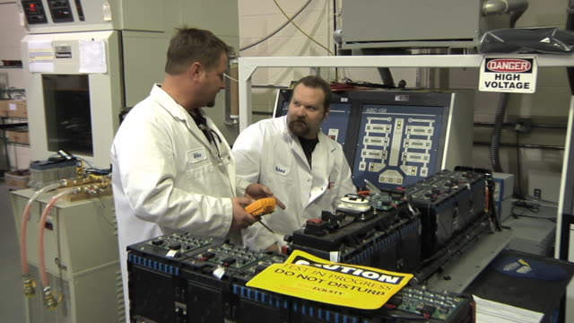 ms zo technicians confer while testing prototype lithium ion battery used to power electric automobile / troy, michigan, usa - lithium ion battery stock videos & royalty-free footage