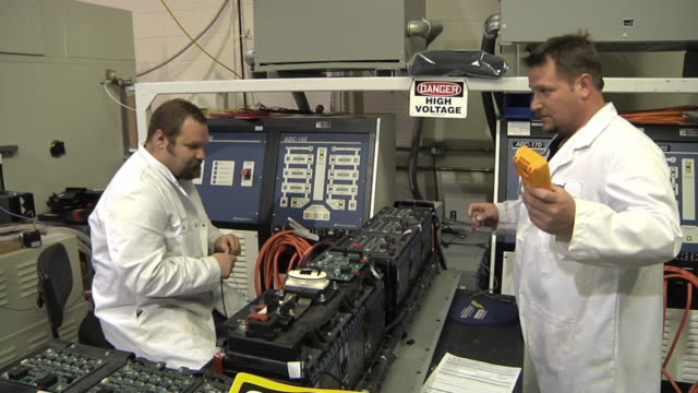 ms technicians confer while testing prototype lithium ion battery used to power electric automobile / troy, michigan, usa - lithium ion battery stock videos & royalty-free footage