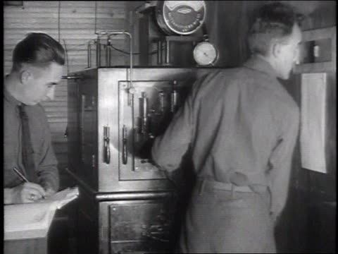 technicians in other room operating the machine and taking notes during the xray procedure / patient being helped up afterward - camp x ray stock videos & royalty-free footage