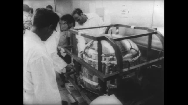 technicians in white coats remove biosatellite ii from back of truck and transfer into space station in cape canaveral, florida / scientists remove... - sample holder stock videos & royalty-free footage