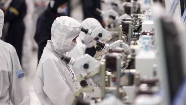 cu technicians inspecting newly manufactured semiconductors under microscopes / bang pa-in, ayutthaya, thailand - conductor stock videos & royalty-free footage