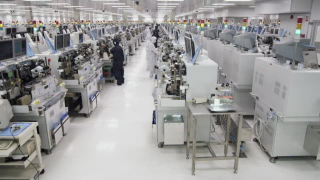 WS PAN Technicians inspecting newly manufactured semiconductors under microscopes / Bang Pa-In, Ayutthaya, Thailand