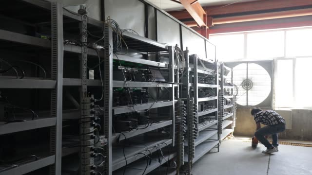 technicians make repairs to bitcoin mining machines at a mining facility operated by bitmain technologies ltd in ordos inner mongolia china on friday... - cryptocurrency mining stock videos & royalty-free footage