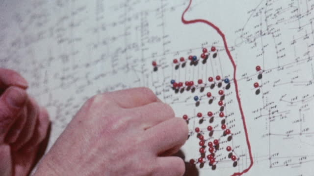 montage technicians marking and plotting sewer system map for baiting and killing rats / united kingdom - 土木技師点の映像素材/bロール