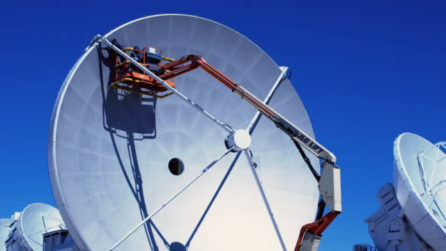 ms technicians perform maintenance above 5000m on an antenna at alma / san pedro de atacama, chile - atacama large millimeter array stock videos and b-roll footage