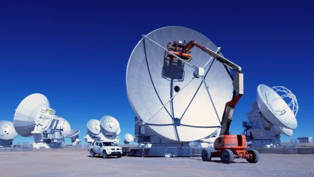 ws technicians perform maintenance above 5000m on an antenna at alma / san pedro de atacama, chile - atacama large millimeter array stock videos and b-roll footage
