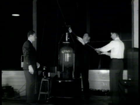 technicians pulling sample rod out of 'argon' tank reactor ms man using geiger counter ms geiger counter measuring radiation of reactor - contatore geiger video stock e b–roll