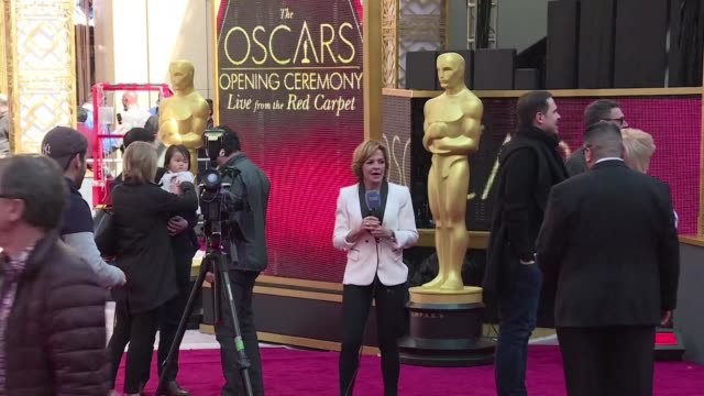 stockvideo's en b-roll-footage met technicians put the final touches on the set on the red carpet outside the dolby theater on the eve of the oscars ceremony - dolby theatre