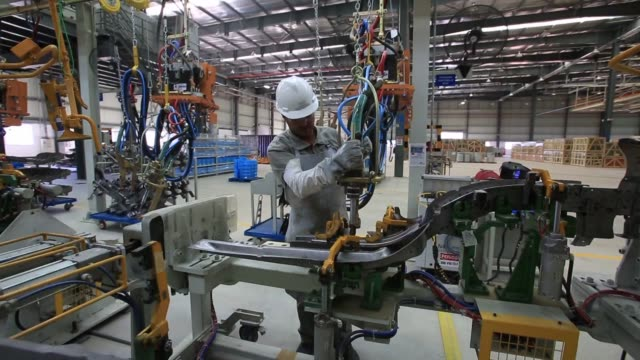 Technicians test and finish up the assembly lines and machines in order to start industrial production until the end of 2014 at a newly inaugurated...