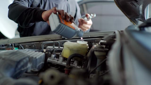 technicians working on an engine. - service stock videos & royalty-free footage
