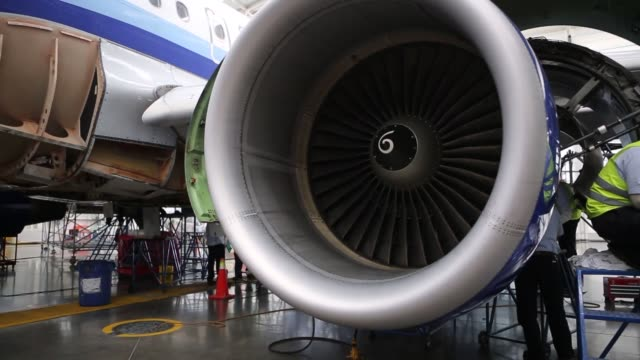 vídeos de stock e filmes b-roll de technicians working on the exterior of an interjet plane passenger seats are inspected and bolted together in an interjet hangar interjet airplane... - banco do passageiro