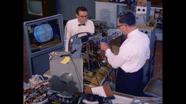 MS Technicians working on tv screen in lab / United States