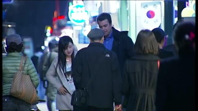 technology helps outside world seep into north korea south joo chanyang and reporter towrds - 2013年 北朝鮮の核実験点の映像素材/bロール