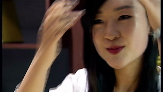 technology helps outside world seep into north korea woman wearing pink baseball cap int joo chanyang interview sot close shot name plate necklace... - korea stock-videos und b-roll-filmmaterial