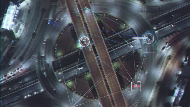 vidéos et rushes de technologie hud multipath visual tracker target,connection technology with aerial view road traffic intersection.transportation concept. technologie de connexion et de réseautage - brillant