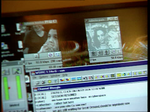 internet access: bt deal; lib england: london: tcbv child and woman using pc in internet cafe screen tcbv two children using computer - internet café stock-videos und b-roll-filmmaterial