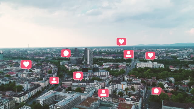 Technology Marketing Concept Aerial View of Cityscape with pop up Social Media Like Comment Follower Icons