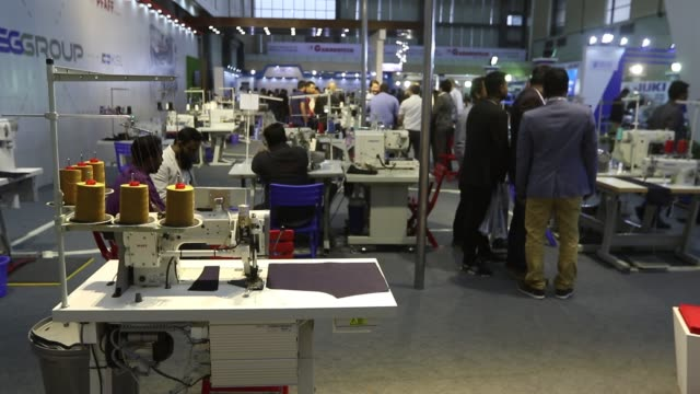 technology suppliers, agents and garment manufacturers visit garmentech international tradeshow 2019 at bashundhara international convention city in... - garment stock videos & royalty-free footage
