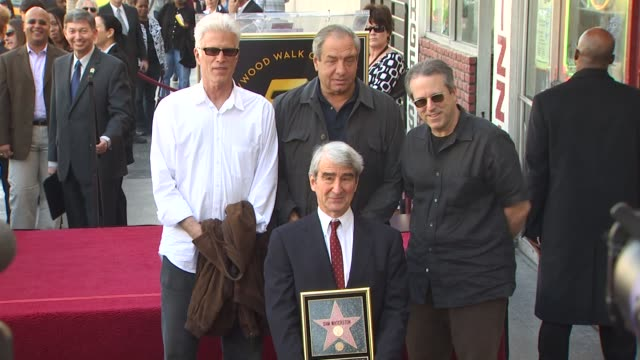 vídeos de stock, filmes e b-roll de ted danson dick wolf and sam waterston at the sam waterston honored with a star on the hollywood walk of fame at hollywood ca - ted danson
