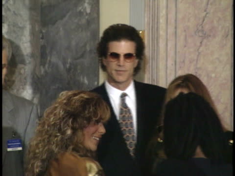 vídeos de stock, filmes e b-roll de ted danson stands nearby while whoopi goldberg is embraced by and converses with woman danson walks over to reporters - ted danson