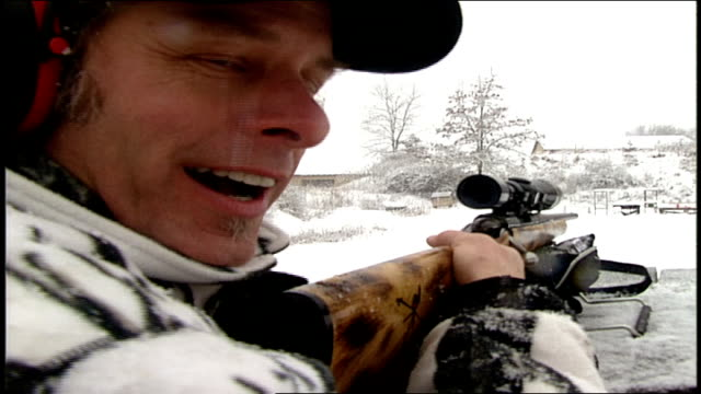 ted nugent shooting jugs full of red liquid in the snow - ted nugent stock videos and b-roll footage