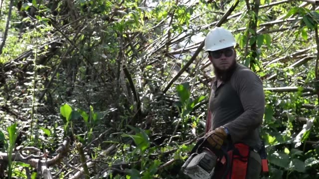 Ted Piehl a US Forest Service smokejumper with the Redmond Air Center clears trails and debris around the El Yunque National Forest water supply in...