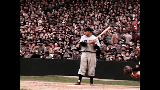 ted williams of the red sox hitting with yogi berra of the yankees as catcher; large crowd of people in the audience; yankees baseball player with... - baseball world series stock videos & royalty-free footage