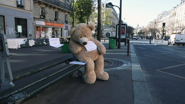 teddy bears are displayed outside a newsagent in the 'les gobelins' area on april 15, 2020 in paris, france. the bears, known as les nounours des... - テディベア点の映像素材/bロール
