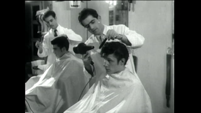 teddy boy gets a haircut and visits a tailor; 1955 - barber stock videos & royalty-free footage
