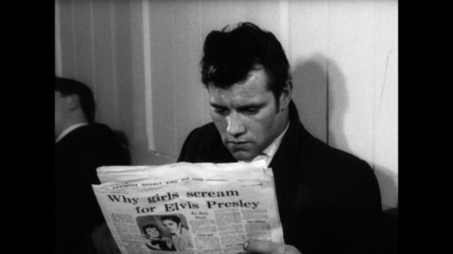 teddy boy reads newspaper in a cafeteria; 1960 - only men stock videos & royalty-free footage