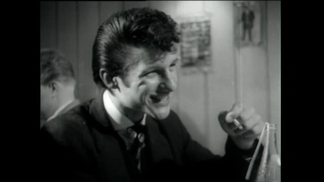 teddy boy smiles and takes a drag on cigarettte; 1955 - 1955 stock videos & royalty-free footage