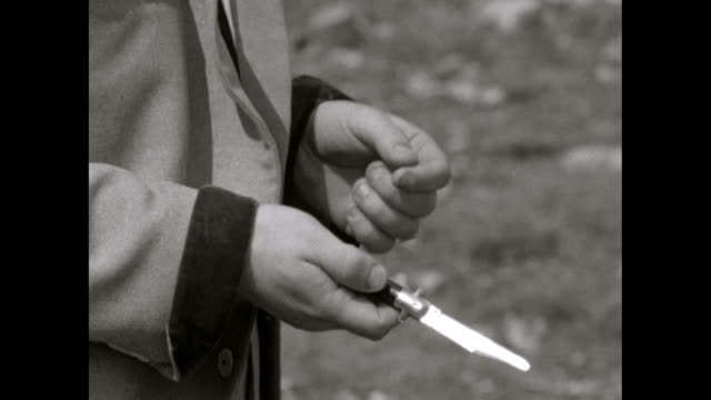 cu of teddy boys' hands testing weapons and flick knife - weaponry stock videos & royalty-free footage