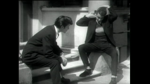 teddy boys sit on doorsteps combing hair; 1955 - 1955 stock videos & royalty-free footage