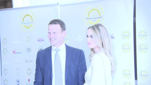 teddy sheringham and kristina andrioti at the 4th annual national film awards at porchester hall on march 28, 2018 in london, england. - ポーチェスター点の映像素材/bロール