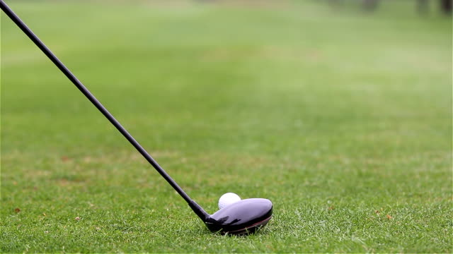 tee shot with driver - golf swing from behind stock videos & royalty-free footage